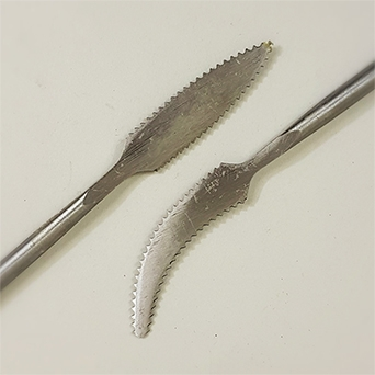 FORGED METAL MODELLING TOOL SPEAR WITH UPTURN